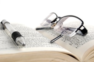 dictionary & pen with glasses