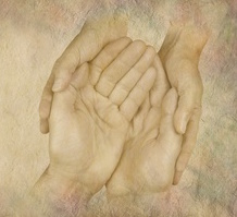 Caring for those in need website banner - female hands cupped gently around male hands on a wide rough stone effect background and copy space on left