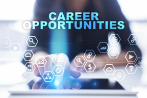 """Woman is using tablet pc, pressing on virtual screen and select """"Career opportunities""""."""